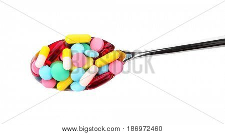 Diet concept. Spoon with pills on white background