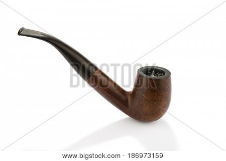 Used smoking pipe with burned tobacco isolated on white background.
