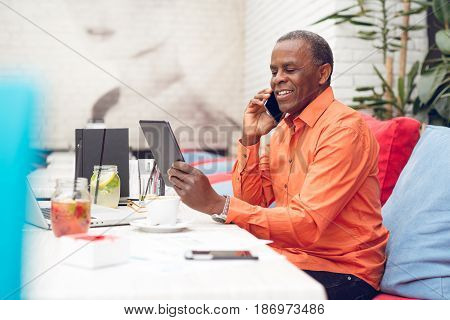 Businessman looking over electronic tablet closeup picture