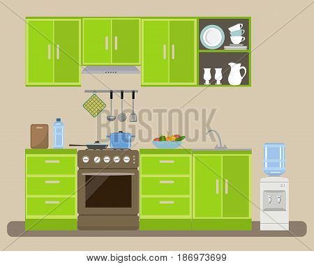 Modern kitchen in a green color. There is a kitchen furniture, a stove, a water cooler and other objects in the picture. On the table is a plate of vegetables. Vector flat illustration.