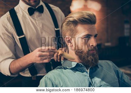 Classy Dressed Barber Shop Hairdresser Is Cleaning Client`s Neck With A Brush And Presents His Work