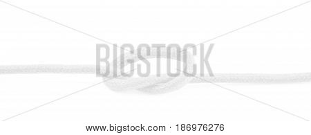 Shoelace knot isolated over the white background