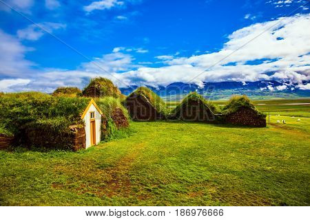Ethnographic Museum-estate Glaumbaer, Iceland. The picturesque village of old houses covered with turf and grass. The concept of the cultural and historical tourism