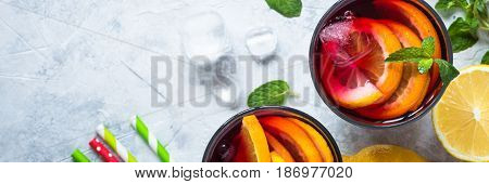Sangria with fruit mint and ice. Traditional alcoholic cocktail. Summer drink. Long banner format.