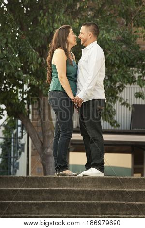 Hispanic couple holding hands outdoors
