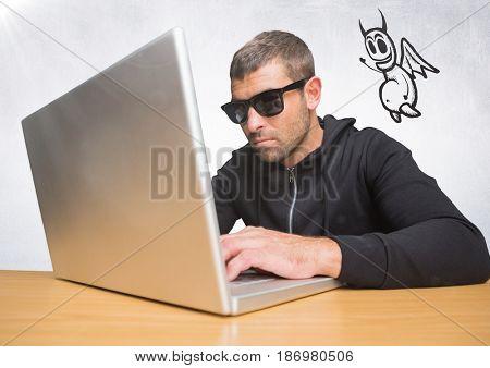 Digital composite of Criminal on laptop with devil icon floating alongside