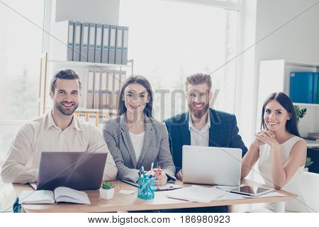 Group Of Cheerful Successful Young Business People Welcoming In Their Company`s Sunny Workspace. All