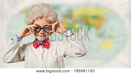 Digital composite of Kid scientist against blurry map