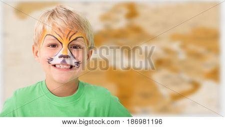 Digital composite of Boy with facepaint against blurry brown map