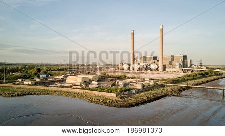 An aerial view of the decommissioned Tilbury A and B fossil fuel power stations located on the banks of the River Thames in Essex England.
