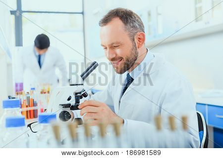 young doctors in uniform working at testing laboratory laboratory technicians