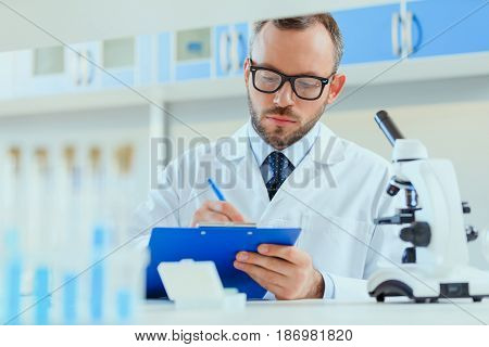 Young Doctor In Uniform Working At Testing Laboratory At Clinic, Chemical Laboratory