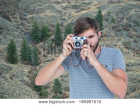 Digital composite of mountain travel, men teiking a photo in the mountains