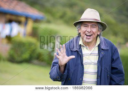 Hispanic man waving