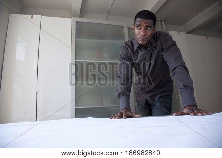 Black businessman reviewing blueprints