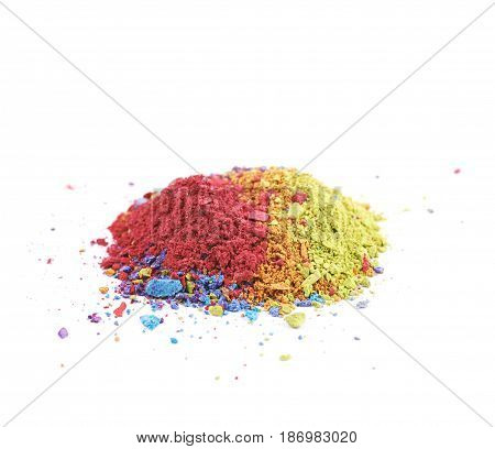 Pile of dusted colorful paint pigment isolated over the white background