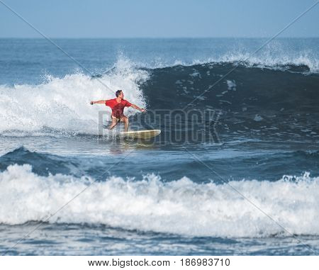Man surfs in an ocean