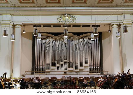 CRACOW POLAND - SEPTEMBER 25 2015: View of the stage of the concert hall at the Cracow Philharmonic with the new Orgelbau organ in the background. Cracow Poland