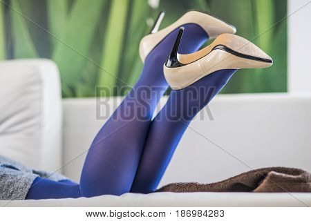 Woman's Leg In The Shoes