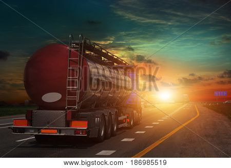 tanker on the big highway, at sunset on the road Working visit .