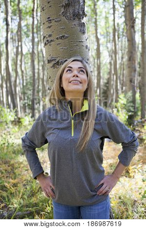 Hispanic woman standing in forest