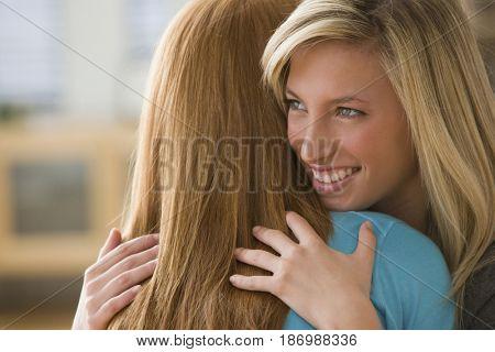 Caucasian teenage girls hugging