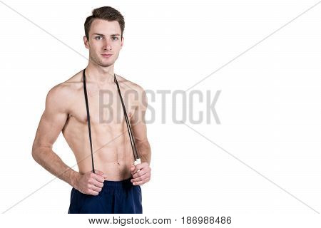 Healthy Lifestyle And Fitness. Handsome Guy Sports A Physique, With A Naked Body, With A Skipping Ro