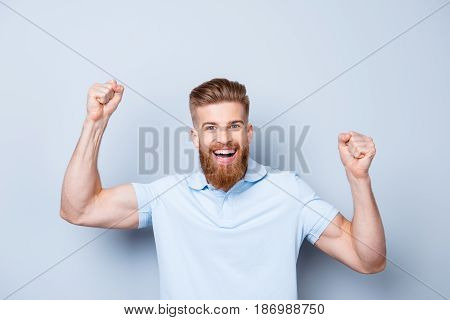 Great Job! Very Excited Young Red Bearded Stylish Freelancer Is Celebrating The Growth Of Conmpany`s