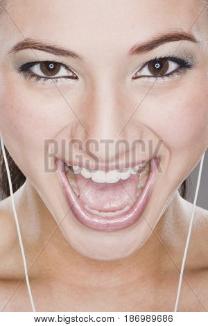 Smiling mixed race woman listening to headphones