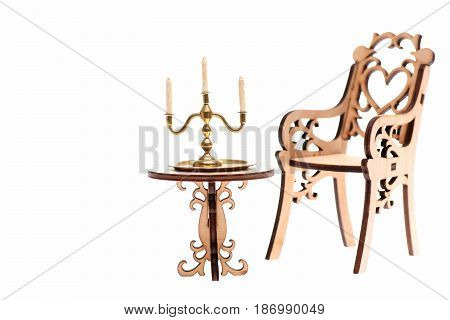 Candelabrum From Gold On Table And Decorative Wooden Chair