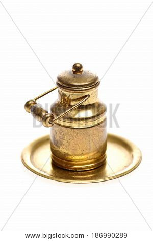 Antique Milk Can On Golden Tray Isolated On White