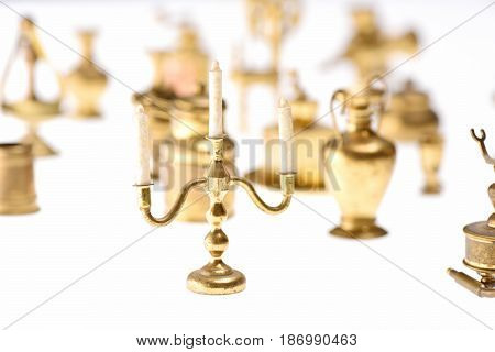 Golden Candlestick On Table And Decorative Wooden Chairs