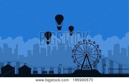 Amusement park scnery on blue background silhouette vector