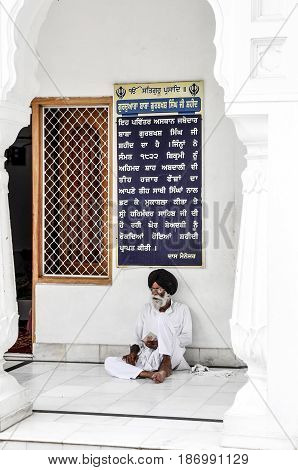 Amritsar India september 4 2010: Indian sikh sitting on a floor in Amritsar.