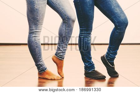 Female Legs In Denim Pants And Socks