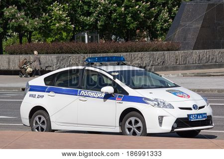 Donetsk Ukraine - May 17 2017: Police patrol car with the symbol of the self-proclaimed Donetsk People's Republic on the city street