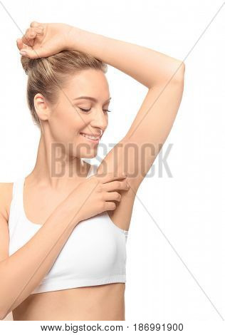 Beautiful young woman with depilated armpit on white background