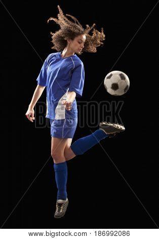 Caucasian soccer player kicking ball