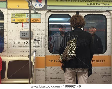 Moscow Russia - September 07 2016: Whole Moscow metro train is dedicated to Year of literature in Russia. Posters contain quotes from well known books. There are QR-codes for downloading free books on the posters.