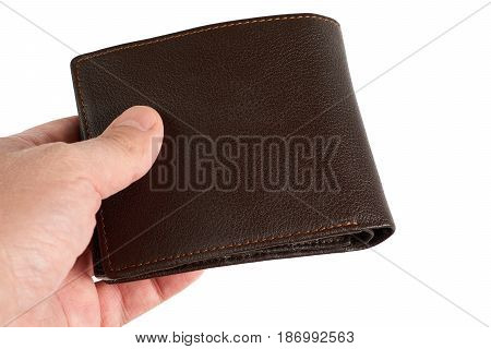 Person holds brown leather wallet isolated on white background