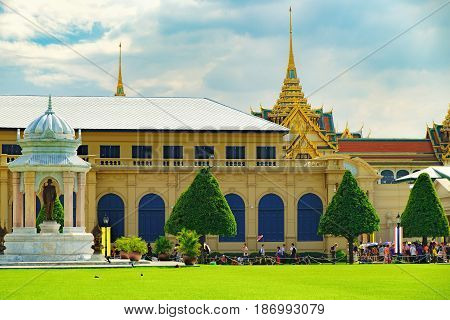 Bangkok, Thailand - December 8, 2015: Tourists visit the Grand Palace in Bangkok, Thailand. Grand Palace is the most famous temple and landmark of Thailand.