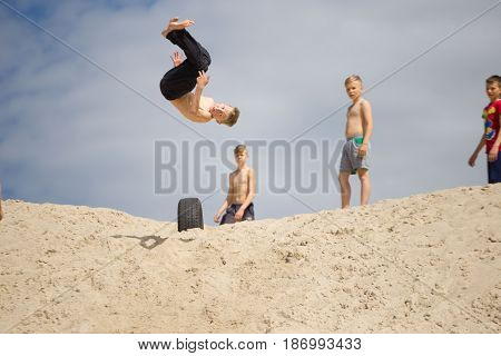 Gomel, Belarus - May 13, 2017: Teens Study Parkour On Their Own. Acrobatics In The Sand.
