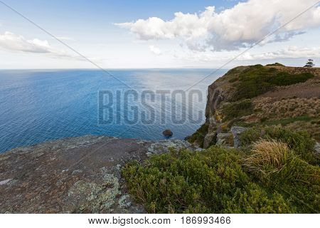 Bass sea Strait from lookout on top of the Nut Plateau tableland in Stanley during Autumn in Tasmania, Australia. The nut is old volcanic plug of basalt with the height of 143 meters rising from ocean