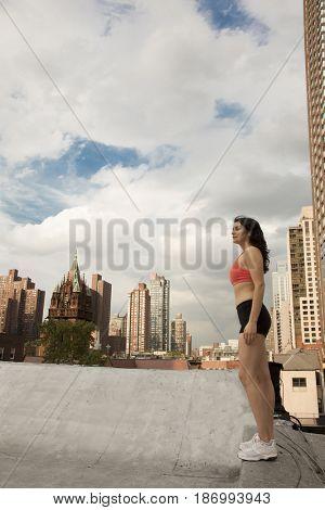 Woman in sportswear on rooftop