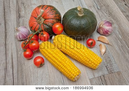 Vegetables lie on a wooden table. Horizontal photo.