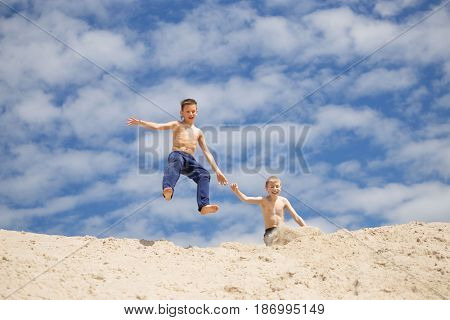 GOMEL BELARUS - May 13 2017: Teens study parkour on their own. Acrobatics in the sand