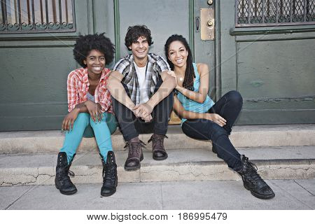 Friends hanging out on front stoop