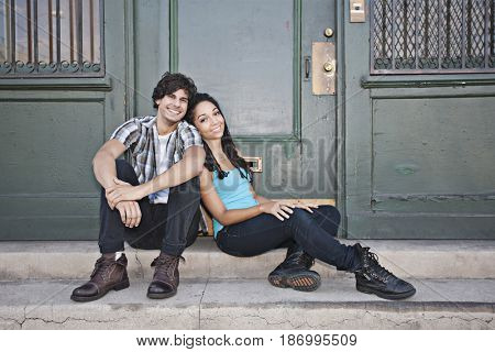 Couple leaning on each other on front stoop