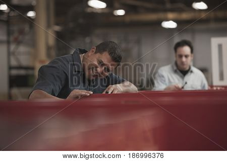 Hispanic worker working in warehouse