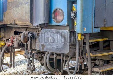 Rusty railway wagon metal bumpers close-up, transportation